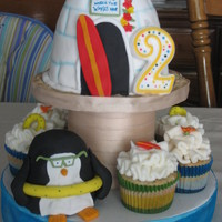 Surfer Penguin A cake and cupcakes I mad for my son's 2nd birthday. Cookie ad Cream yum yum. The penguin in cake too.