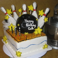 Bowling Fun! Bowling birthday cake inspired by our beloved Cake Girls. The ball is cake and the pins and stars are gumpaste. Thanks for looking