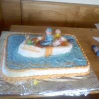 Speed Boat Cake My nephews' bday cake. He loved boats and he wanted one with his family in it. Figures are made with fondant.