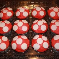 Super Mario Bros i loved making these cupcakes that my customer wanted to go along with the mario cake!