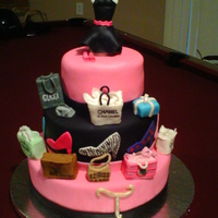 Shopping Diva   cake for a shopping diva. bags and dress form are fondant covered RKT. I had a lot of fun with this one