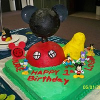 Mickey Mouse Club House i made this for my twin boys first bday. foot is rice krispy treats. everything is ediable except neck is wood support and the toys.