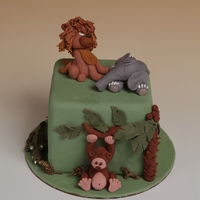 Jungle Love The sleeping elephant, wistful lion, silly monkey and sneaky crocodile.......all living in harmony in this jungle. All fondant and sugar...