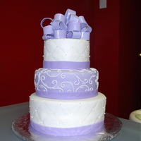 50Th Bday The lady who wanted this cake requested it look just like the wedding cake I did only purple and with the bow.