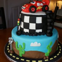 Cars Cake Cars cake for a three year old. WASC with strawberry jam filling, covered in buttercream then fondant. All accents are fondant or royal...
