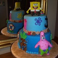 Spongebob Cake Spongebob cake I made for a five year old. WASC cake covered in butter cream then MMF. All accents are fondant or royal icing. It was very...