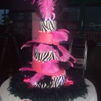 Sweet 16 Cake   This is a topsy turvy sweet 16 cake. Pink velvet covered in fondant and had painted to look like zebra.