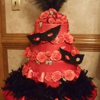 DraculaâS Wedding Cake This is four tiers of red velvet cake with white chocolate filling covored in white fondant with handmade bows, roses and masks then...