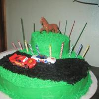 Birthday Cake- Racecar/ Horses This was the first cake I have ever made looking proffessional not just for a fathers day or mothers day present and I think I did pretty...