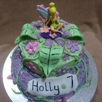 Tinkerbell Cake  A 2-tier cake iced with frosting. The leaves, flowers and vines made out of ready-made fondant. I bought Tinkerbell from an online party...