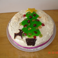 Christmas Tree   This was a simple iced fruit cake, I used glace cherries as the baubles on the tree. The actual tree, and angels were marzipan