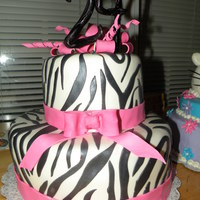 Pink Zebra   This is my favorite zebra cake that I have done so far!! Fondant decor. The bow and spirals are gumpaste TFL