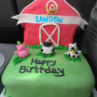 Farm Cake   The animals are made from fondant!The barn is cake covered in fondant. TFL
