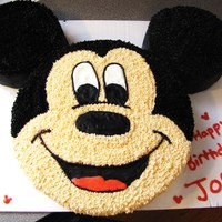 "Mickey Mouse First Birthday Mickey mouse 10' and two 6"" rounds...BC frosting .....I did a piping gel/wax paper transfer...."