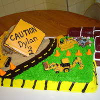 Construction Site This cake took forever. Used the Wilton doll pan for the sand hill. The sand is brown sugar. 1/2 sheet cake and then some more for the...