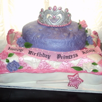 Pillow Cake   This is my first pillow cake, made for my little niece. Cake was covered in fondant, tiara was made of gumpaste.