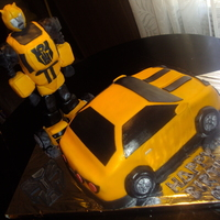 Bumblebee Transformers   Chocolate & vanilla cake, with chocolate filling, covered on fondant. Bumblebee was made of gum paste and rice crispies. TFL.