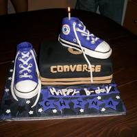 Purple Chucks This cake was made for my sister's birthday. The shoes are made of rice crispies and fondant. the cake was vanilla and strawberry...