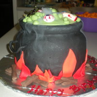 Bubbeling Cauldron Cake  This is a cauldron cake that I made for my niece's Halloween birthday party. I carved the cream cheese pound cake into a cauldron...