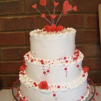 Valentine's Wedding Cake Buttercream Icing. Roses and Hearts are made of gumpaste. Bought the crystals from Hobby Lobby.