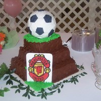 Manchester United Soccer Cake This cake is a devils food cake with a chocolate cream cheese icing. It is a grooms cake and the groom loves Manchester United. The soccer...