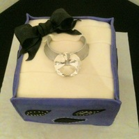 "The Ring In A Box Cake  This cake is another idea I got here from CC. The ""diamond"" is a paper weight I got from Hobby Lobby. The box is decorated in..."