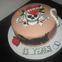 The Ed Hardy Anniversary Cake   This cake was for 2 Ed Hardy lovers. He likes motorcycles and she like jewlery. TFL.