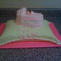Baby Shower Pillow Cake This is my first pillow cake. I was pleased with it. This is a butter cake with chocolate buttercream frosting and strawberry glaze filling...