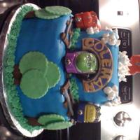 Chugginton Bday Cake This cake was for a 4 year olds bday. He really wanted a tunnel he could see all the way through. Its a vanilla cake with buttercream...