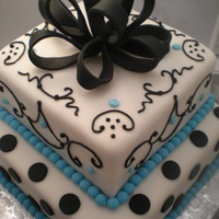 Black, White And Pale Blue Bridal Shower Vanilla cake with lemon buttercream. Covered in fondant with fondant accents.