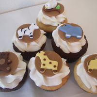 Noah's Ark Baby Shower Cupcakes Made for a baby shower for a little baby boy. 18 chocolate fudge and 18 french vanilla cupcakes all topped with white chocolate SMBC and...
