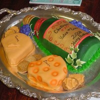 Wine N Cheese Bottle and cheese are cake covered with fondant, the bottles is acceted with gumpast leaves. The crackers are cookies