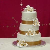 Golden Splendor Buttercreme iced cake with handmade calla-lilies dusted with gold luster dust.