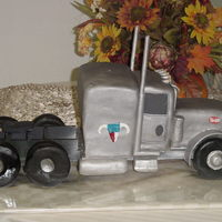 Peterbilt Truck Grooms Cake This was what the groom drove complete with his logos. Truck is all cake covered with fondant on a wood frame with cookie wheels.