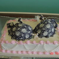 Fancy Bra This cake is buttercreme but the bra is gumpaste with a lace overlay of royal icing.