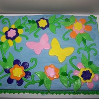 Butterflies And Flowers white sheet cake with mmf flowers and butterflies.
