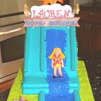 Water Slide Cake Customer asked to make the cake matching the slide they were renting for the party.French Vanilla pound cake w/ choc ganache filling,...