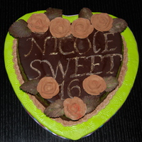All Chocolate Cake Flourless chocolate w chocolate buttercream roses and pipes chocolate letters and leaves.