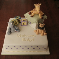 """enchanted Nursery"" Baby Shower Cake  Fondant covered carrot cake with cream cheese filling (the mom-to-be's favourite.The animals are gum paste as are the alphabet cubes..."