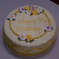 90Th Birthday Cake 90th Birthday cake with royal icing daffodils and buttercream cornelli lace.