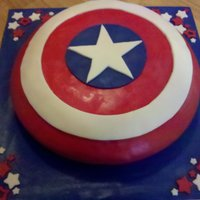 "Captain America's Shield  For a 12 year boy who loves Captain America. This was made from a 16"" cake. Bottom layer was pound cake, top was strawberry. All..."