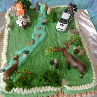 Sleepy Hunter I made this cake for a friend who loves hunting, I also decorate a little truck with the Logo of his company. I had lots of fun doing this...