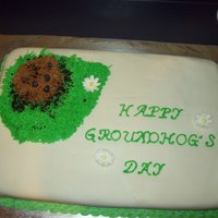 Groundhog's Day A chocolate sheet cake with MMF and Buttercream icing. My first time making MMF and it turned out. My second cake that I covered with...
