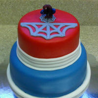 Friendly Neighborhood Webb-Slinger.  I made this cake for a friend's son, who is 8. I used two different brands of fondant (Duff's in red and Wilton I colored blue)....
