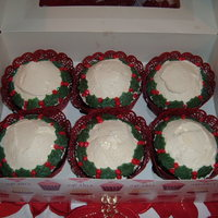 Christmas Wreath Cupcakes Devils Foodcake cupcakes with a fresh strawberry inside. Covered with whipped fresh cream and marzipan holly leaves and berries.
