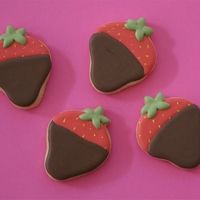 Chocolate Covered Strawberry Cookies   vanilla sugar cookies with RI decorated as chocolate covered strawberries.