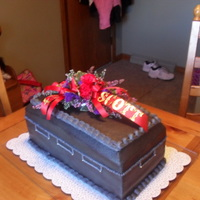 40Th Birthday This is my first casket cake. Had the local florist make me up a mini casket spray with 40 and the name of the Birthday Boy. Buttercreme...