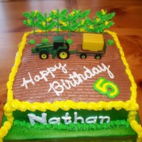 Tractor Cake A friend of mine wanted a birthday cake for her son who LOVES John Deere. Chocolae cake with buttercreme frosting. Corn and cabbage/lettuce...
