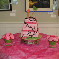 "Birds And Nest Baby Shower Three tiered cake (top tier is styrofoam) with 2 cupcake bouquets. Cake was for a ""co-ed"" baby shower"