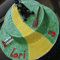 "Wicked Witch Of The West Cake Made for my 3 year old niece who loves the wicked witch more than Dorothy! Also made ""melting witch"" cupcakes"